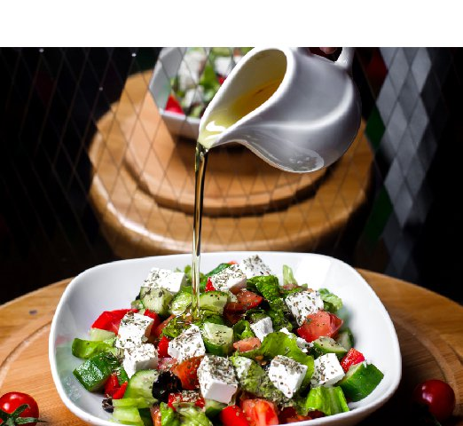 side-view-hand-pouring-olive-oil-fresh-salad-with-feta-cheese-tomatoe-cucumbers-white-bowl_Resize